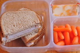 turkey on whole wheat bread, cheese, carrots