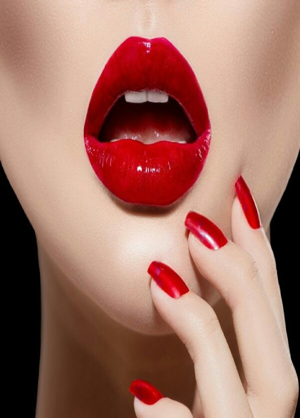 a small layer of vaseline on your teeth will keep from your red lipstick sticking on your teeth!