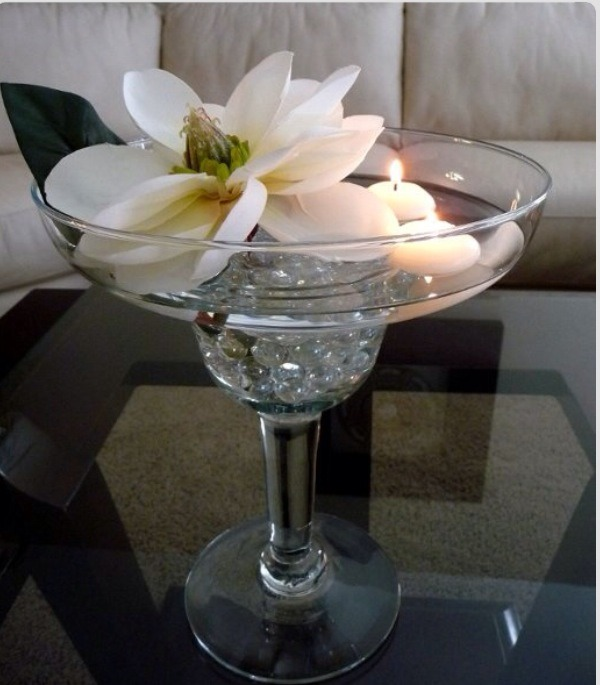 Margarita centerpiece, pebbles, floating candles, & white Magnolia.