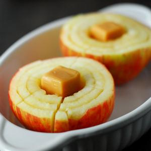 Place the apples in an oven safe dish and put two caramels into the center of each apple.