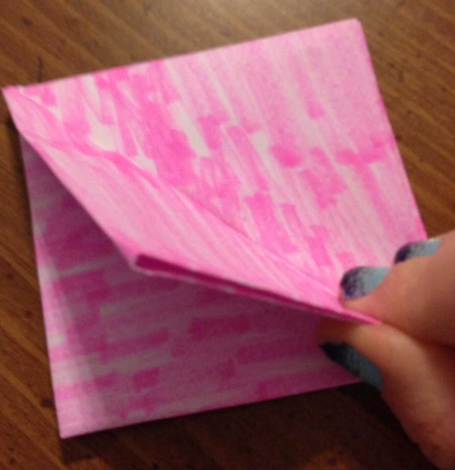 Pick up the corner of the top layer and fold it completely flat against the other side. Flip it over and repeat. Basically you're pulling it apart so that the part that was on the inside of the fold is now on the outside of the fold. Like if you opened a greeting card and laid it down flat.
