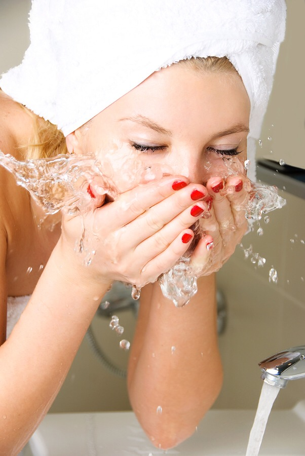Then wet your face and put soap on your face as well.  Then remove the soap with water and pat your face dry.