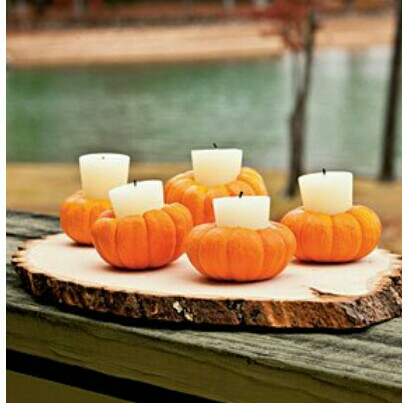 small gourds as votive candle holders...