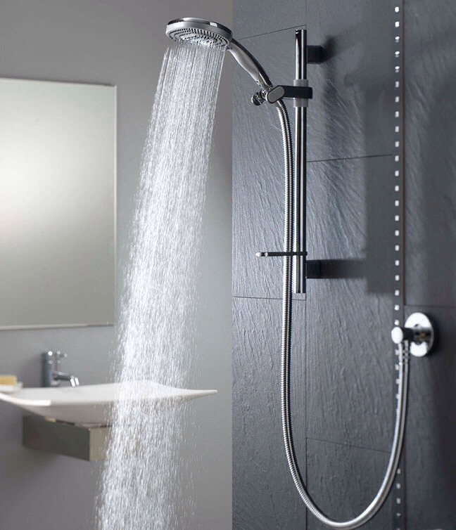 Shower as soon as you wake up. It will make you feel awake and refreshed and keep you from laying back down.