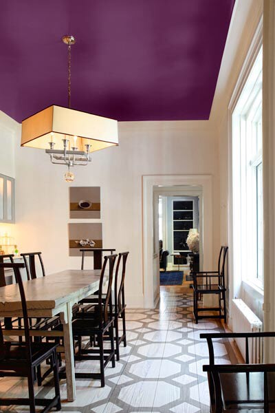 Paint the ceiling instead of the walls. This will give the illusion of higher ceilings.