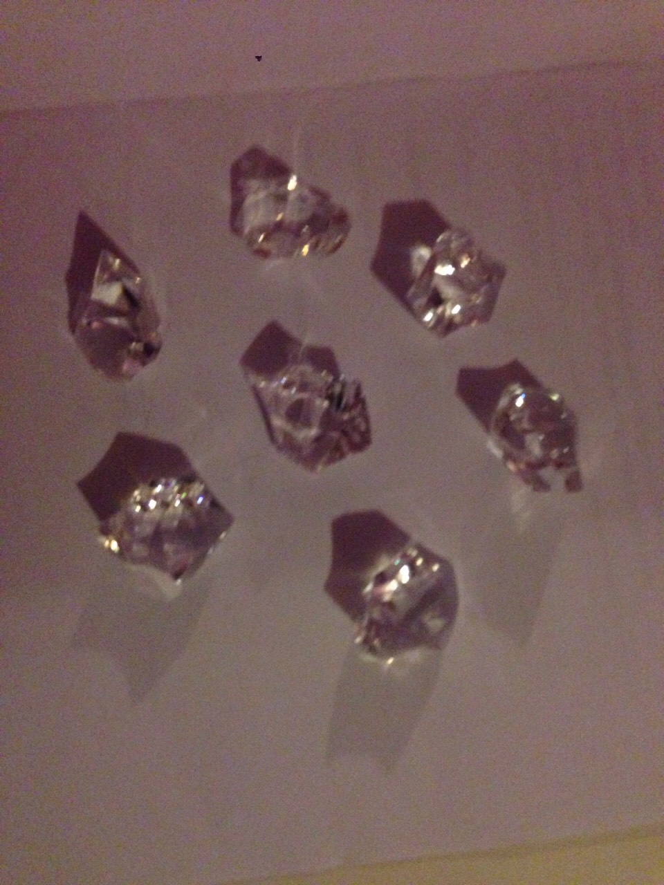 Then get any sized/shaped rinestones and place them carefully in the glass bowl
