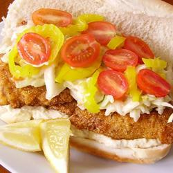 """""""Crispy fried catfish is piled into hoagie rolls and topped with tangy coleslaw for this authentic Po Boy sandwich."""""""