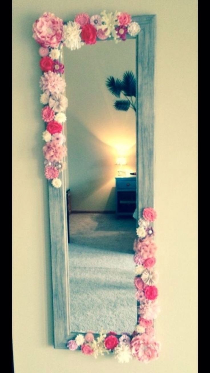 An easy DIY is to just glue or tape on some fake flowers to the corner of your mirror to add some texture to it