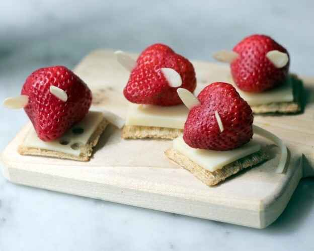 Strawberry with almond slices on cheese & cracker makes an adorable mouse.