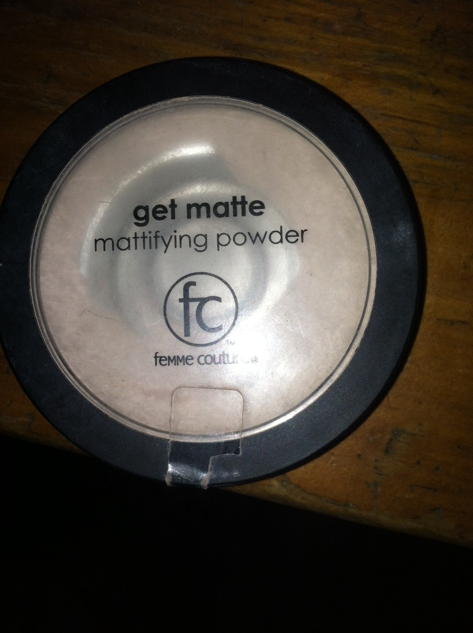 Next you use mattifying powder. This one is my favorite this one also cost around $12. So you use the makeup brush and spread evenly around your face. This will stop your face from looking oily after the liquid foundation. You can use this through out the day also to help with the oilyness.