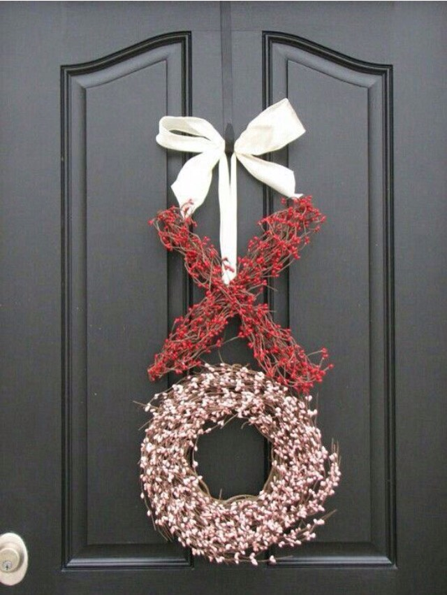 Get wreaths from the store, and hang them together to make this easy and festive sign!