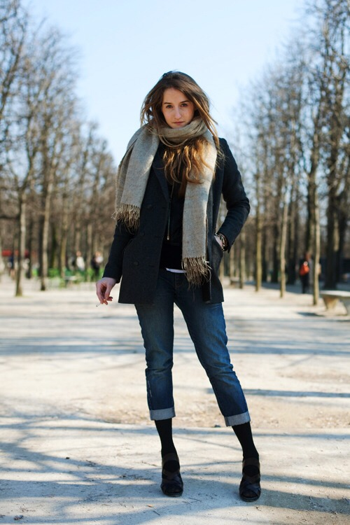 Don't wear jeans or street pants. Denim is not waterproof, so water will soak through and you'll end up cold, wet and miserable.  Skin tight jeans won't allow you to retain any of your body heat! You'll be frozen after 5 minutes. :(
