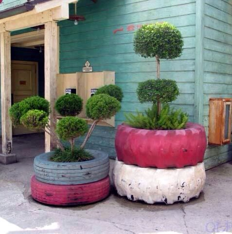 Using some old tyres - try painting them a bright colour- and place round your trees.  Looks really nice