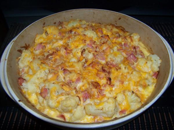 Delicious cheesy cauliflower ham casserole. I used mostly almond milk because it is both low calorie and low carb. A bit of cream was added in for flavor.