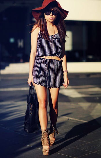 7. Kill two summer trends in one outfit by wearing a colorful floppy hat with a romper.