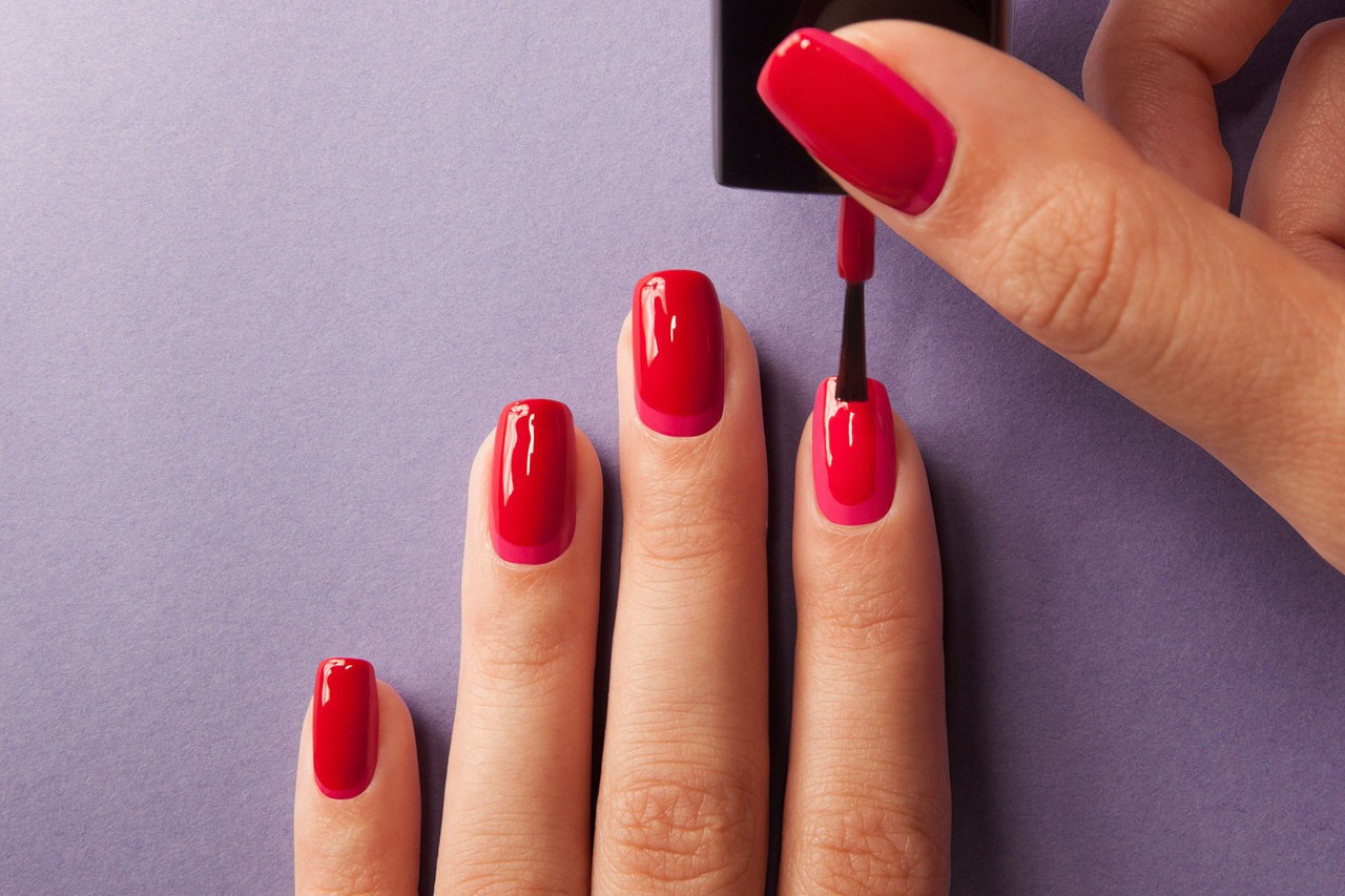 Manicures are best done in two thin coats rather than one thick coat. The easiest way to paint your nails is to angle the brush forward and parallel to the side of your nails.