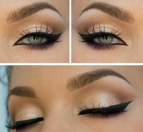 Nice winged black eyeliner & purple shadow on bottom lash line