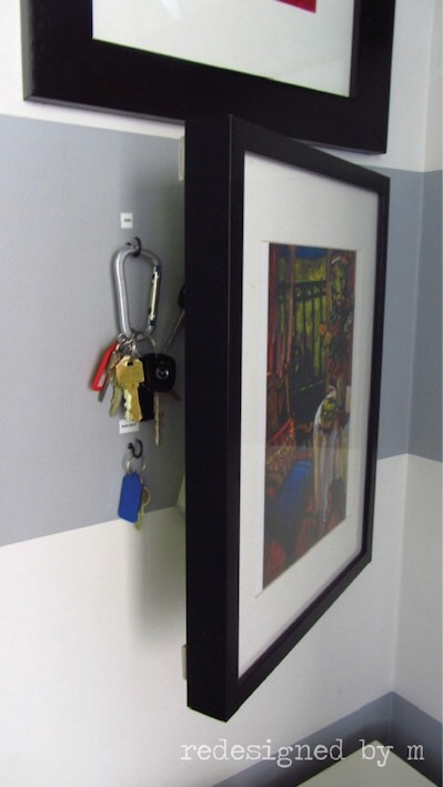7. Picture Frame Storage  If you don't like the idea of having all of your keys on display, cover them up with a picture frame or a piece of art. via Planq Studio