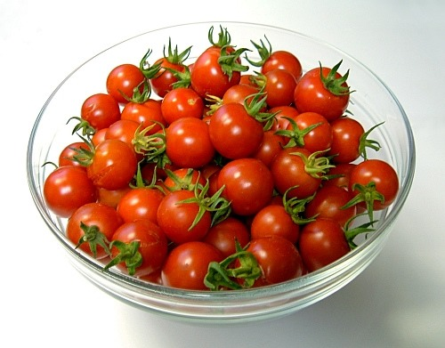 Cut the cherry tomatoes in halves and sauté them with evoo and some garlic
