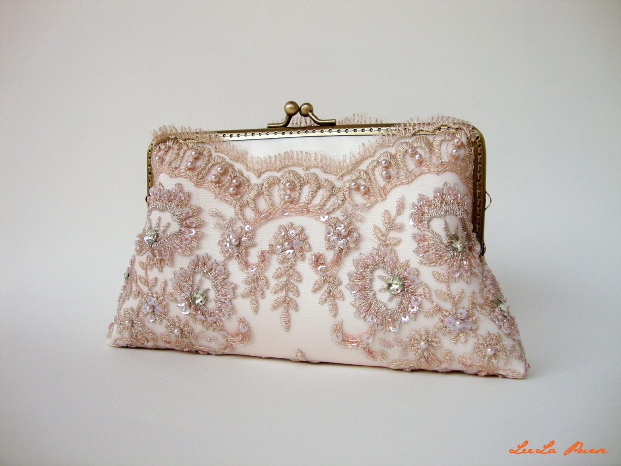 This is a small yet stylish wallet it goes really nice with the dress