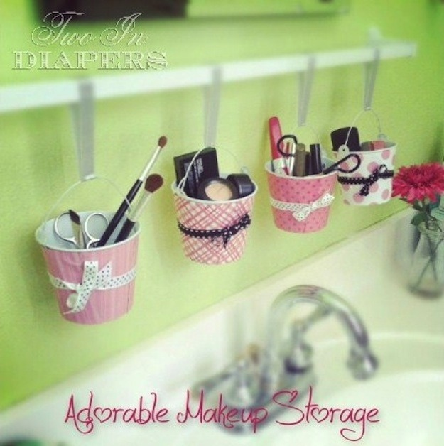 This organizer is made of craft store pails, a shower rod, and ribbon. Mason jars work just as well! They might just be the right materials that will help your organize your makeup.