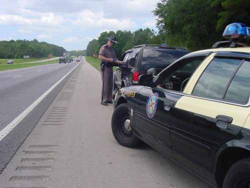 Traffic Cop Pulling Someone Over : Musely