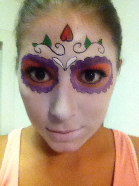 Outline the eyes with eyeliner and add eyelashes