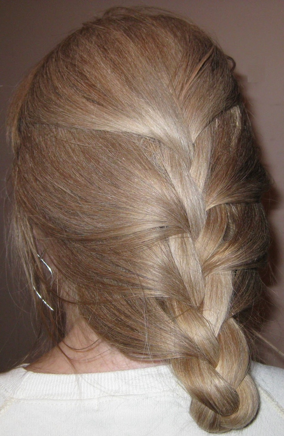 My sister just puts it in a simple braid when it's damp usually a braid like this but u could do a few, like 3-4 French braids for like 20-30 mins and when you take it out it won't be frizzy and have a nice wave to it.