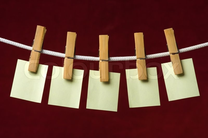 Hang sticky notes on a rope line with clothespins. You can also add quotes, sayings, and reminders.