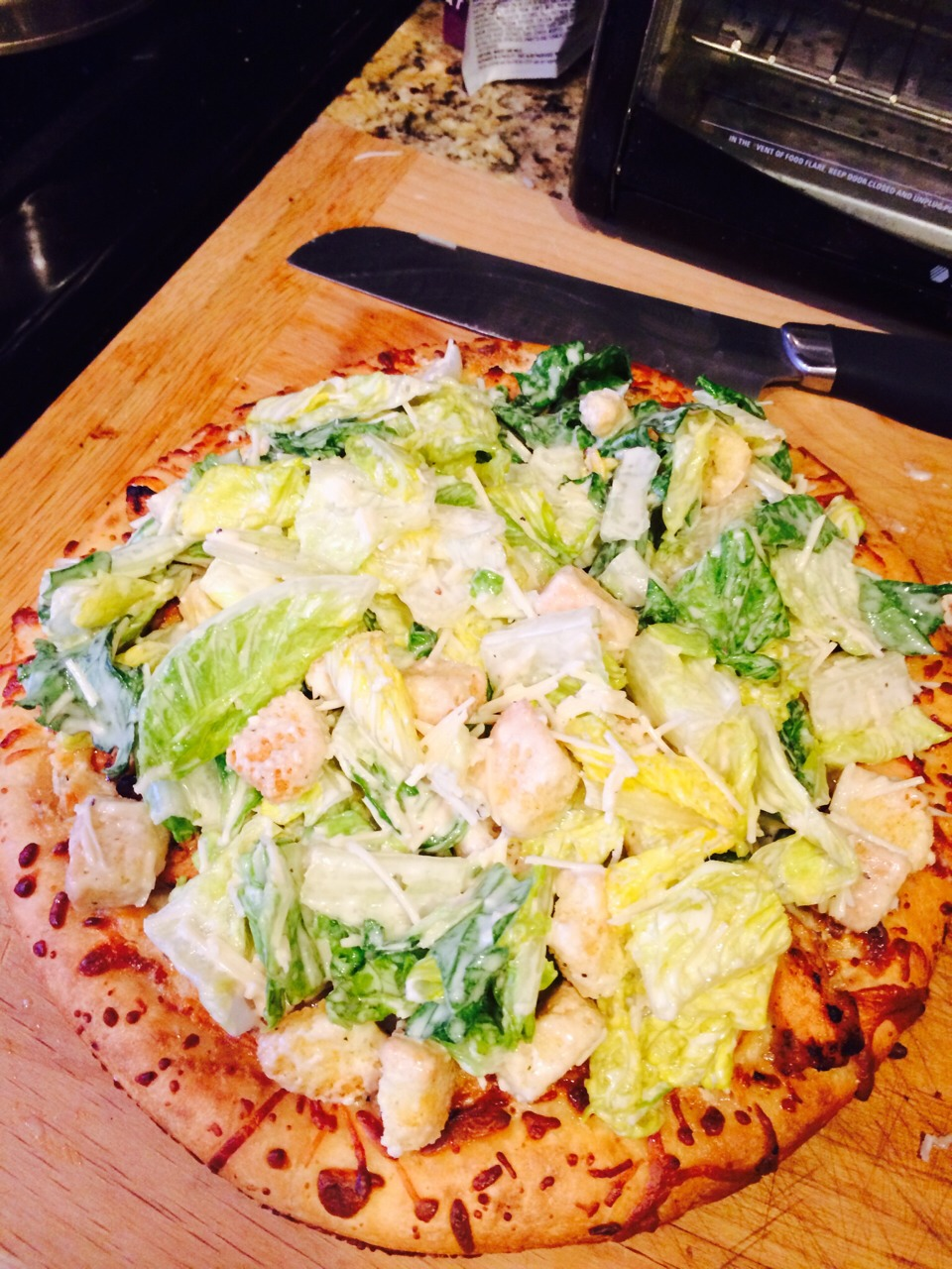 Put your salad on top of your pizza, cute it up and ENJOY!!!