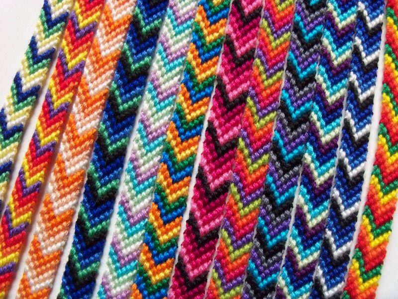 To make a simple chevron bracelet You will need: 4 different coloured lengths of embroidery thread Tape or a safety pin
