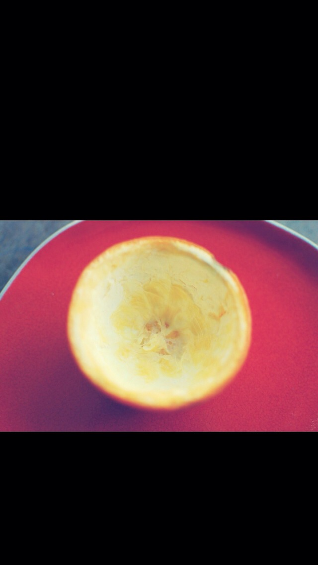 Scrape out the citrus inside and you should have an orange peel bowl!
