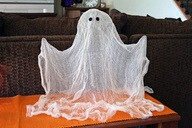 Once it is completely dry, pull it off of your form and glue on some felt eyes. And Voila! Floating ghost!
