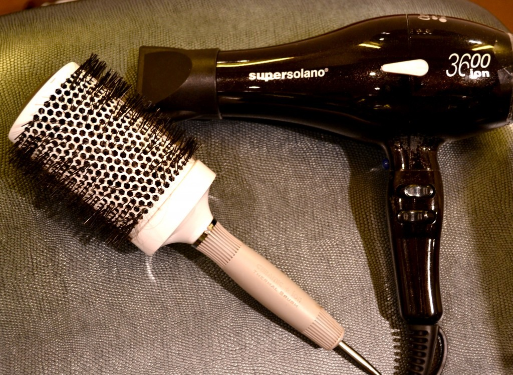 If you have a problem with frizz, a boar bristle brush the ideal to smooth out the cuticle and prevent frizz. Also, keep the blowdryer pointed down instead of sweeping it up and down your hair.