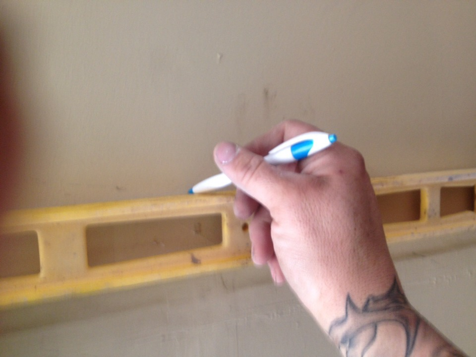 Step 1- using the level, mark a straight/level line around the perimeter of the bathroom. This will help you keep everything looking nice and level.