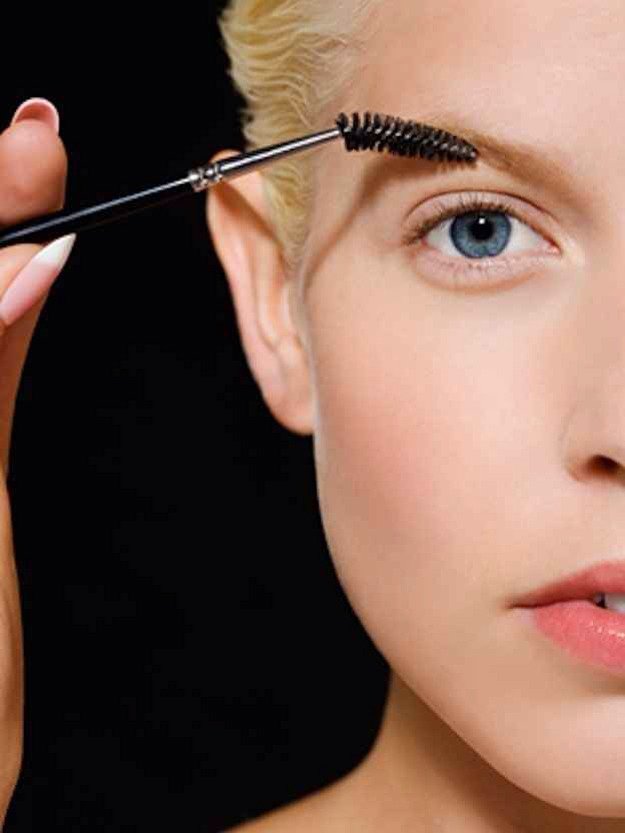 Use a mascara wand to tame your brows.