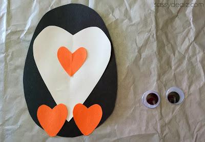 Glue the hearts onto the penguins body.