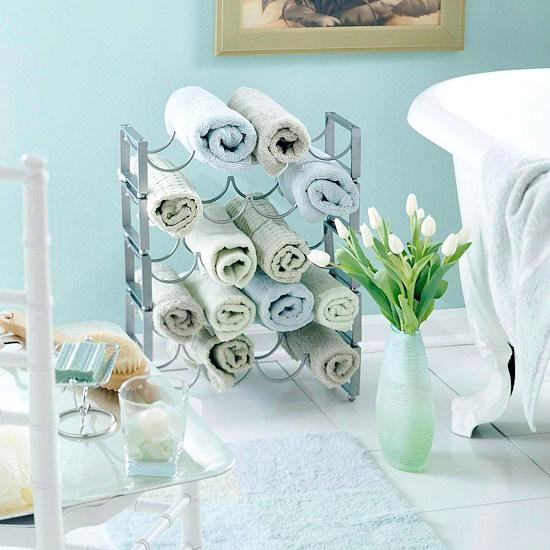 roll up extra towels in a large pottery piece or wine rack