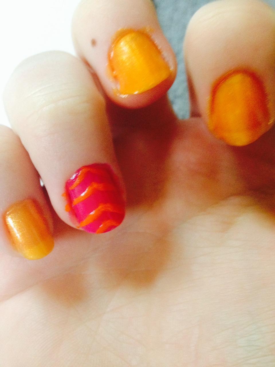 ... Paint orange stripes on your nails
