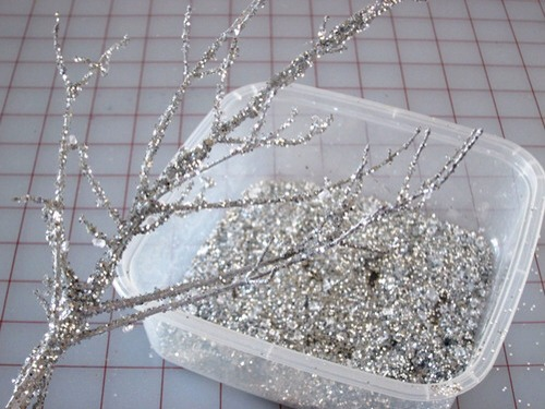 - first place newspaper down on your work station - take branches you found and spread tacky glue evenly on them  - next sprinkle on branches color diamonds and glitter