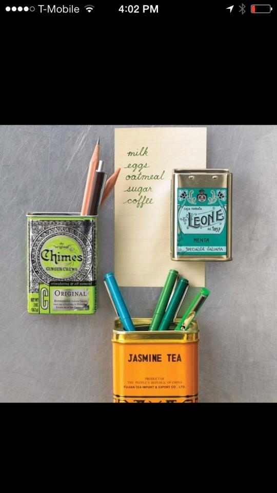 Put a magnet inside of  old tea tins to attach to your fridge for some cute storage and decor!