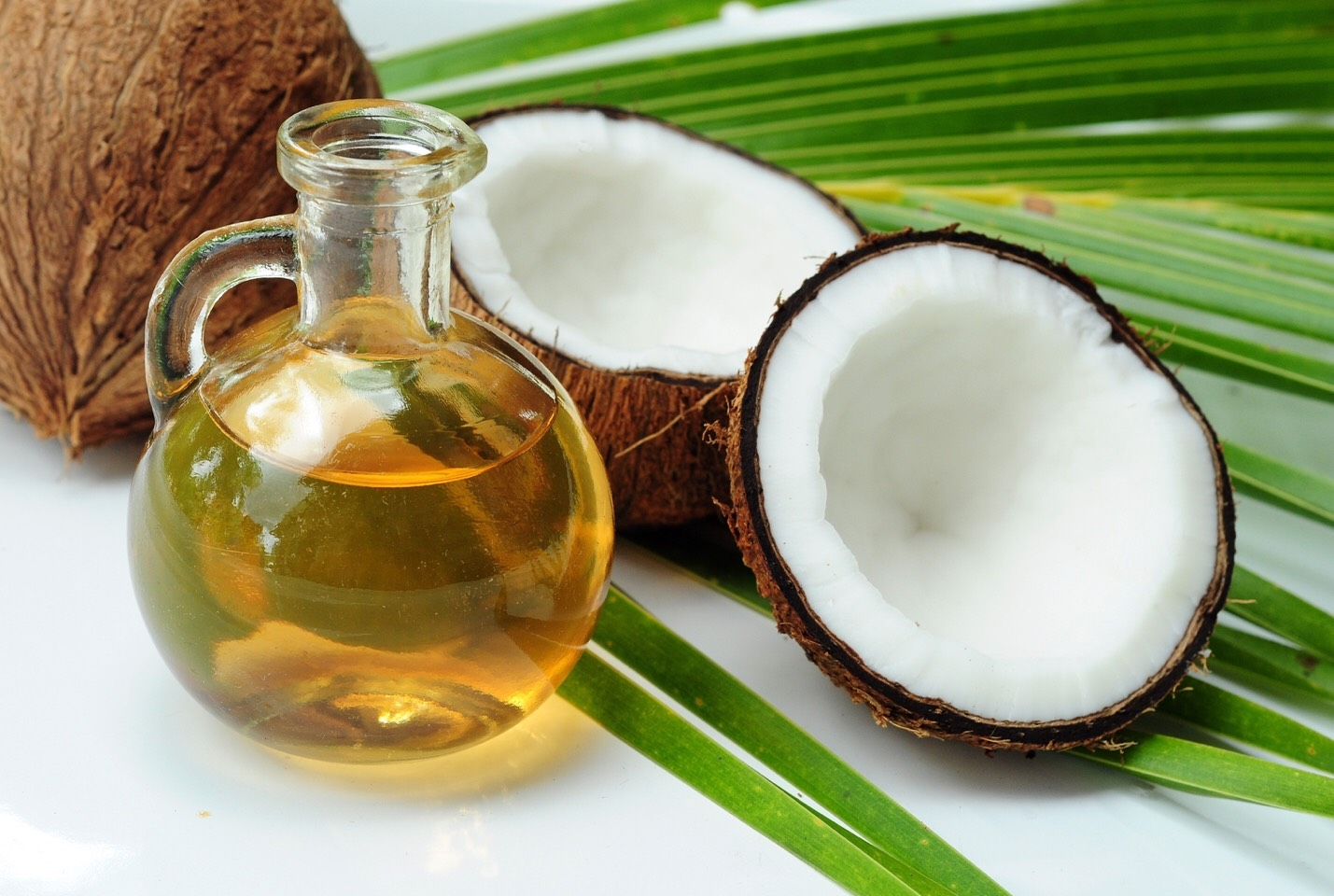 Putting coconut oil in your hair when it is wet will help keep frizz under control. *remember* a little goes a long way!!