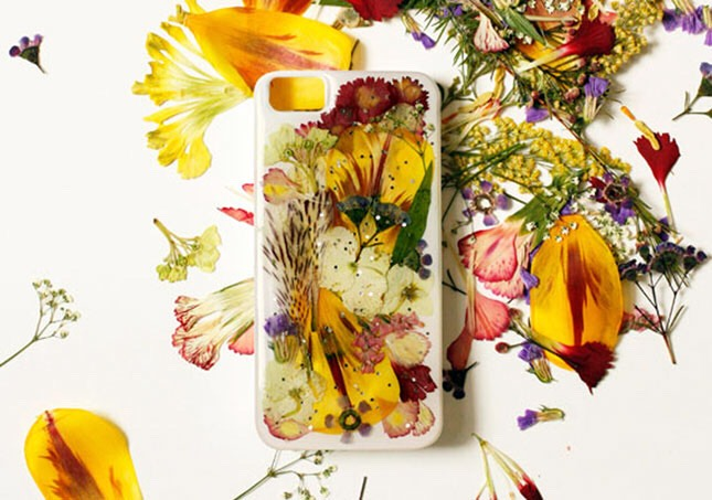 8. Pressed Flowers Case: Feeling a little Midsummer Night's Dream? This gorgeous case was made using pressed flowers, resin, and a whole bunch of popsicle sticks.