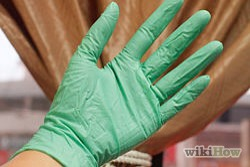 Wear rubber gloves when cleaning. Harsh chemicals dry out the nails, make them brittle, and more likely to break. The chemicals are also detrimental to cuticles.
