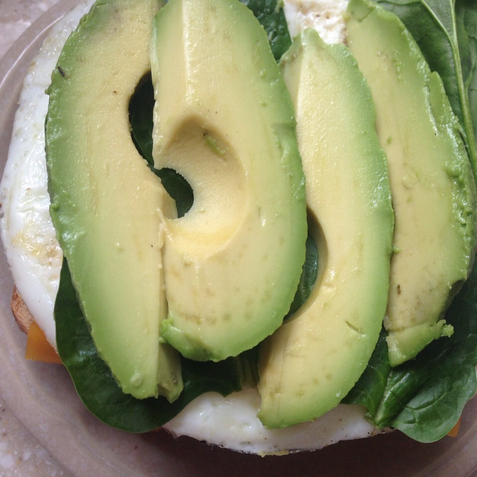 Next, prepare and wash your spinach and cut up your avocado into slices.  And top it off.  If you wanted to add a dressing you could try plain greek yogurt!