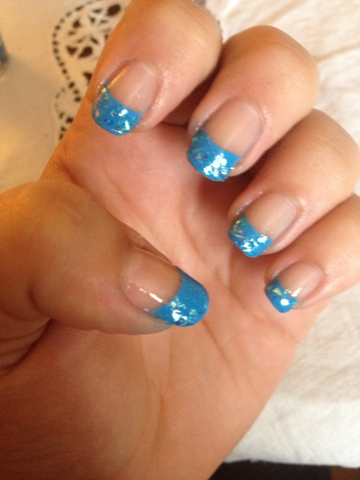 Then add the glitter flakes over the top of ur blue tips.