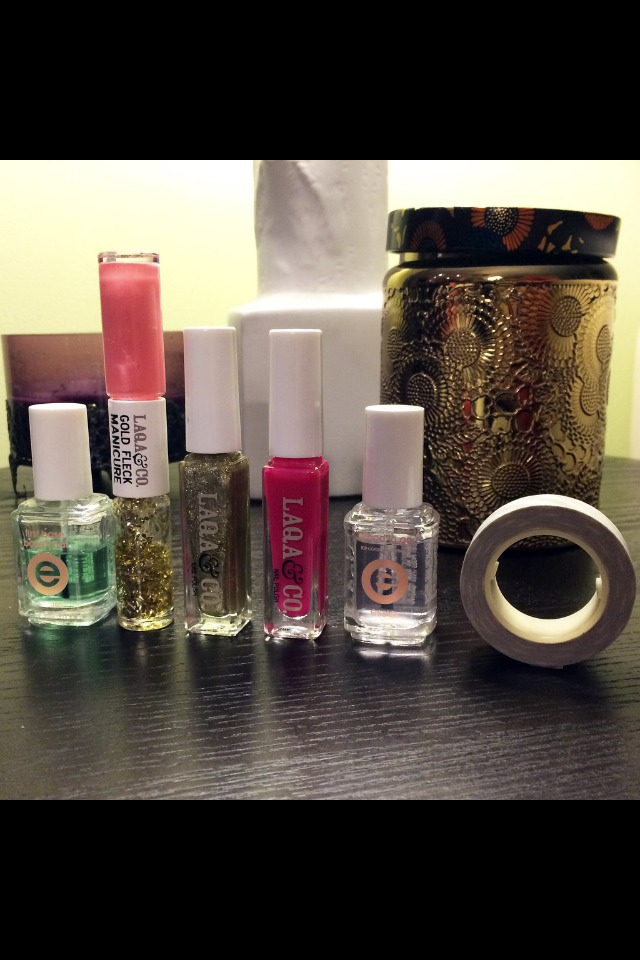 Essie First Base Base Coat ($9), Laqa & Co. Cagney Gold Fleck Manicure Duo ($16), Laqa & Co. Chubs Nail Polish ($13), Laqa & Co. Bounty Hunter Nail Polish ($13), Essie Good to Go Top Coat ($9), and tape.