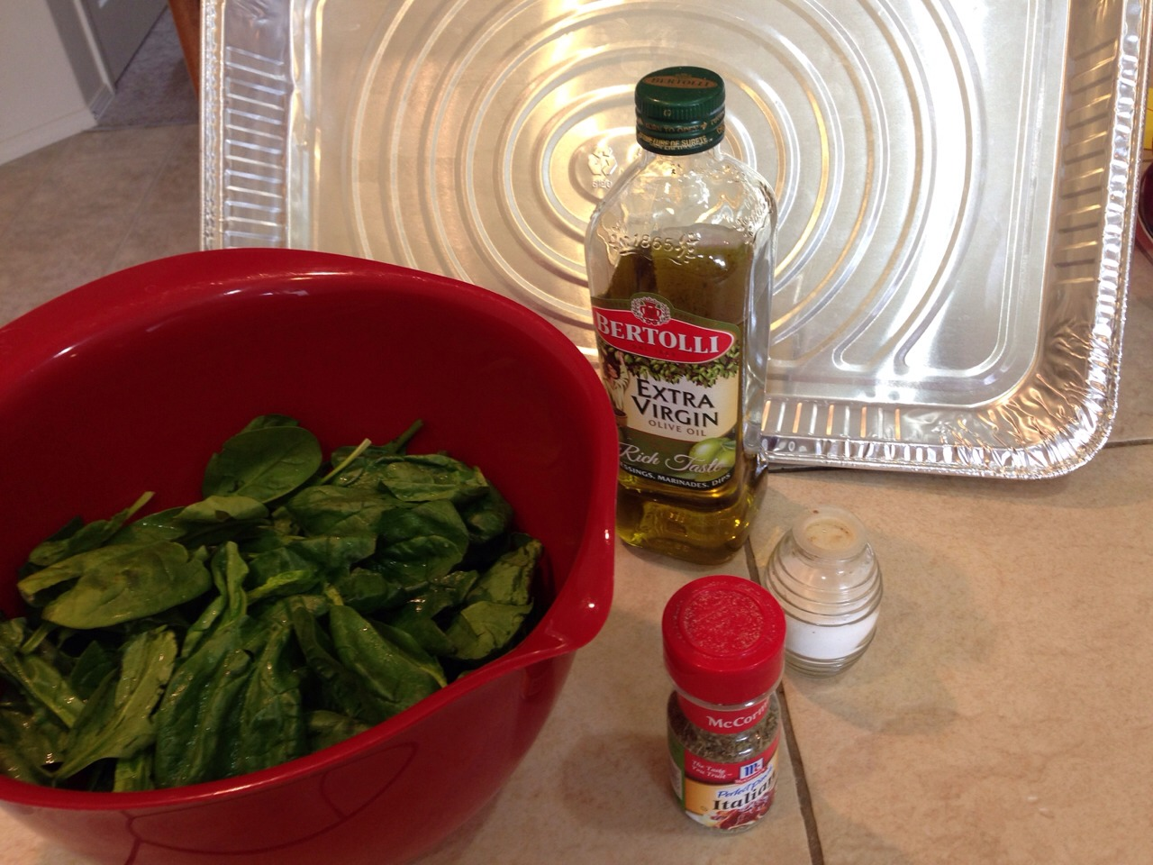 You will need one bag of cleaned spinach, olive oil, salt, and Italian seasoning
