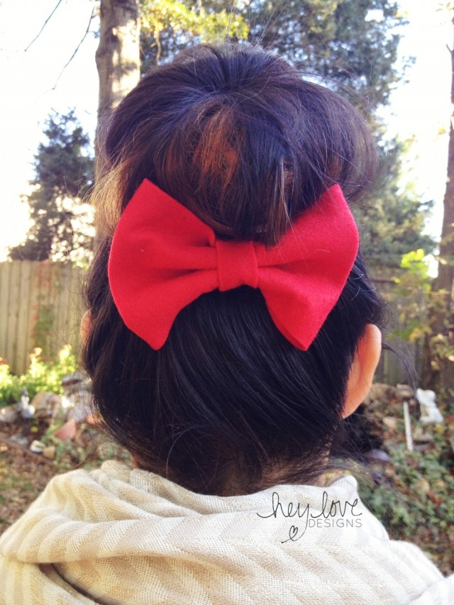 Then simply clip any bow to the underside of your bun to create a super cute (less than 5 minute) hair style!