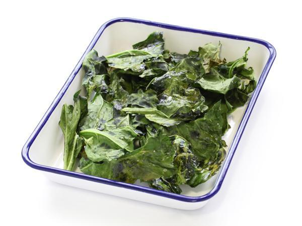 Kale Chips  Kale chips are a super-nutritious stand-in for potato chips or crackers& so delicious! 1. PREHEAT the oven to 325° F. 2. TOSS the kale with the olive oil &salt. 3. PLACE on a baking sheet. Bake for 10 -15 minutes, mixing once half-way through. The kale should be crispy,not browned.